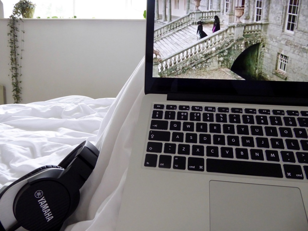 MacBook Pro, Yamaha headphones, in bed