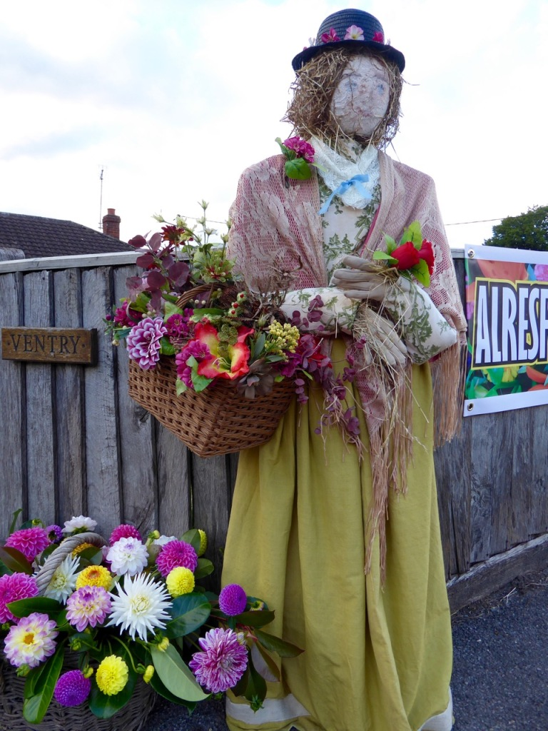 Lady scarecrow with flowers, at the Alresford Scarecrow festival